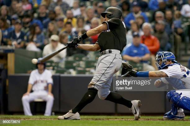 T Realmuto of the Miami Marlins hits a single in the third inning against the Milwaukee Brewers at Miller Park on April 22 2018 in Milwaukee Wisconsin