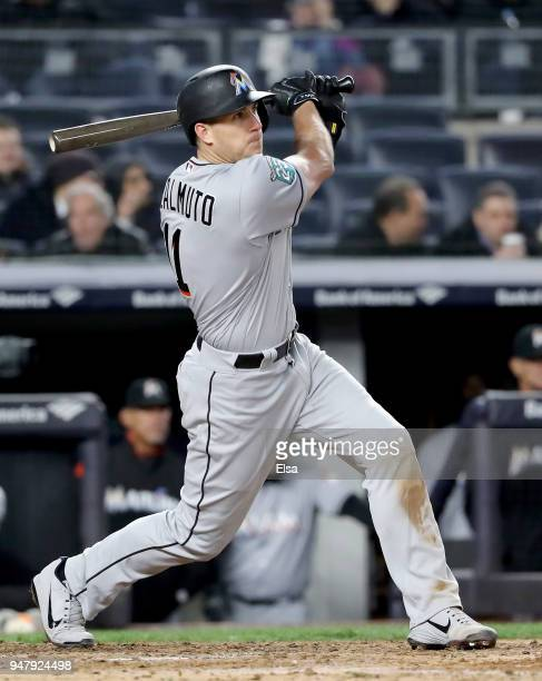T Realmuto of the Miami Marlins hits a three run home run in the fifth inning against the New York Yankees at Yankee Stadium on April 17 2018 in the...