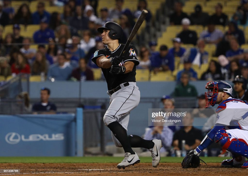 J.T. Realmuto #11 of the Miami Marlins hits a two-run homerun to left field in the eighth inning during the MLB game against the Los Angeles Dodgers at Dodger Stadium on April 25, 2018 in Los Angeles, California. The Marlins defeated the Dodgers 8-6.