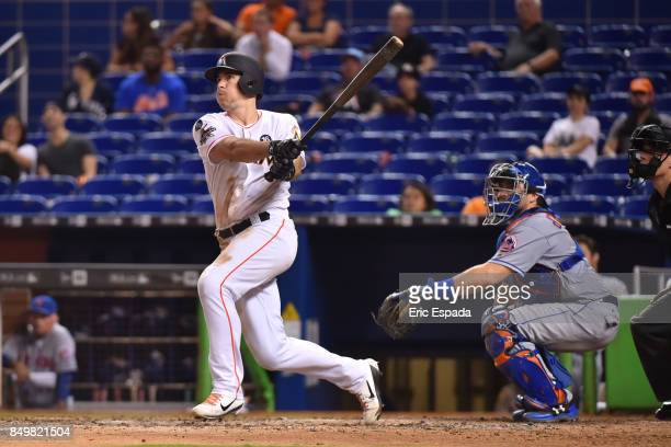 T Realmuto of the Miami Marlins hits a walk off home run in the tenth inning against the New York Mets at Marlins Park on September 19 2017 in Miami...