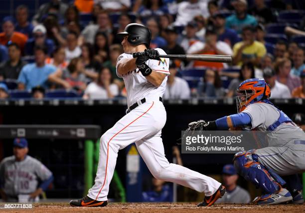 T Realmuto of the Miami Marlins hits a walkoff double to score Miguel Rojas during the ninth inning of the game against the New York Mets at Marlins...