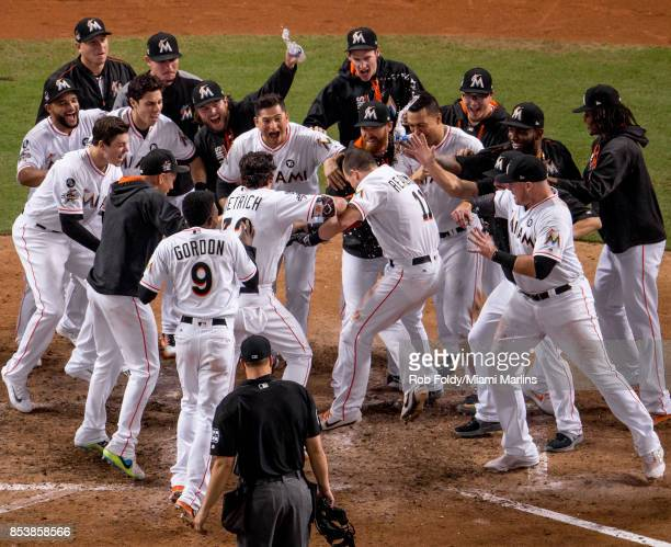 T Realmuto of the Miami Marlins hits a walkoff home run during the tenth inning of the game against the New York Mets at Marlins Park on September 19...