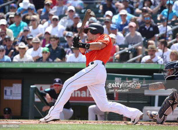 T Realmuto of the Miami Marlins hits the ball against the New York Yankees during a spring training game at Roger Dean Chevrolet Stadium on March 11...