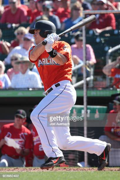 T Realmuto of the Miami Marlins hits the ball against the St Louis Cardinals during a spring training game at Roger Dean Chevrolet Stadium on...