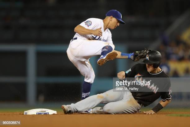 T Realmuto of the Miami Marlins is tagged out at second base by c of the Los Angeles Dodgers during the eighth inning of a game at Dodger Stadium on...