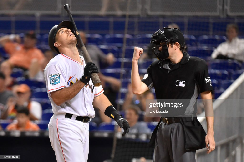 J.T. Realmuto #11 of the Miami Marlins looks up towards the sky after striking out in the eighth inning against the San Francisco Giants at Marlins Park on June 13, 2018 in Miami, Florida.