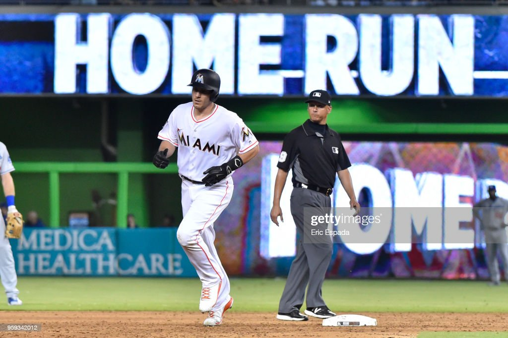 J.T. Realmuto #11 of the Miami Marlins rounds second base after hitting a home run in the sixth inning against the Los Angeles Dodgers at Marlins Park on May 16, 2018 in Miami, Florida.