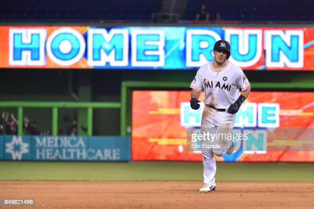 T Realmuto of the Miami Marlins rounds second base at hitting a walk off home run in the tenth inning against the New York Mets at Marlins Park on...