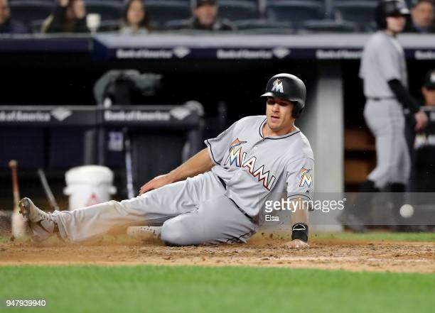 T Realmuto of the Miami Marlins slides home safely in the eighth inning against the New York Yankees at Yankee Stadium on April 17 2018 in the Bronx...
