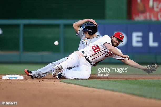 T Realmuto of the Miami Marlins steals second base as Daniel Murphy of the Washington Nationals misses the ball in the third inning at Nationals Park...