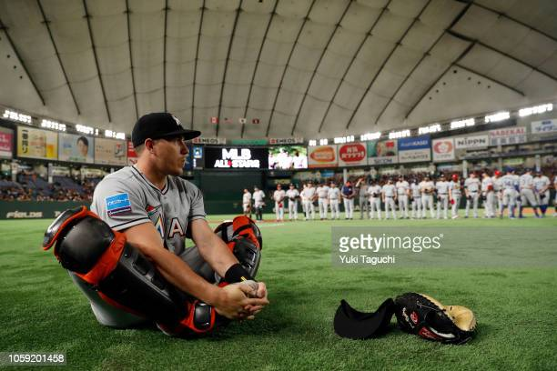 T Realmuto of the Miami Marlins stretches on the field during player introductions prior to the Japan AllStar Series game against the Yomiuri Giants...