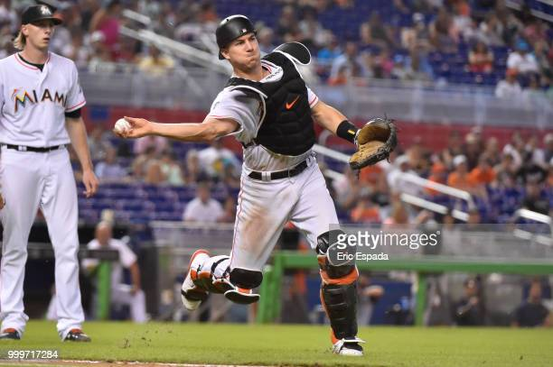 T Realmuto of the Miami Marlins throws towards first base during the eighth inning against the Philadelphia Phillies at Marlins Park on July 15 2018...