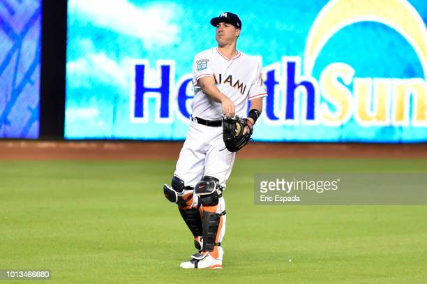 T Realmuto of the Miami Marlins warms up before the start of the game against the St Louis Cardinals at Marlins Park on August 8 2018 in Miami Florida