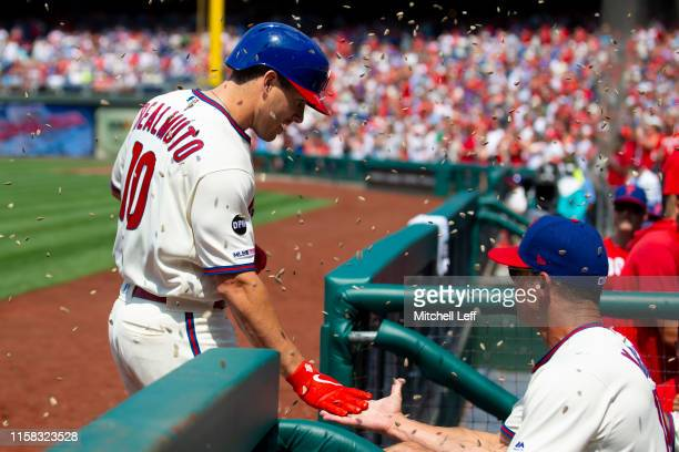 T Realmuto of the Philadelphia Phillies celebrates with manager Gabe Kapler after hitting a grand slam in the bottom of the fifth inning against the...