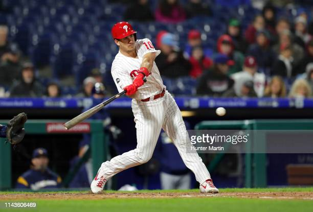 T Realmuto of the Philadelphia Phillies hits a single in the third inning during a game against the Milwaukee Brewers at Citizens Bank Park on May 13...