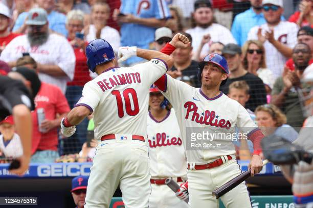 Realmuto of the Philadelphia Phillies is congratulated by Brad Miller after he hit a home run against the New York Mets during the first inning of a...