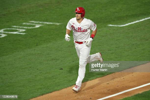 Realmuto of the Philadelphia Phillies jogs home after hitting a three-run home run in the fifth inning during a game against the New York Mets at...