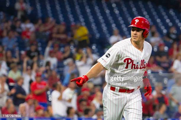 Realmuto of the Philadelphia Phillies reacts after hitting a solo home run in the bottom of the first inning against the Atlanta Braves at Citizens...