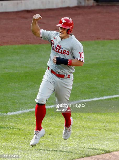 Realmuto of the Philadelphia Phillies reacts as he runs the bases after teammate Jean Segura hit a two-run home run during the tenth inning against...