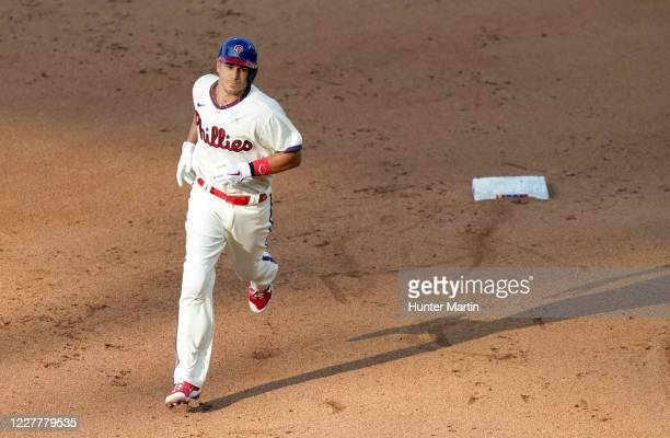 Realmuto of the Philadelphia Phillies rounds the bases after hitting a three-run home run in the seventh inning during a game against the Miami...