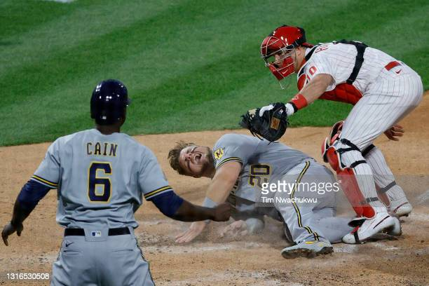 Realmuto of the Philadelphia Phillies tags out Daniel Vogelbach of the Milwaukee Brewers at the plate during the third inning at Citizens Bank Park...
