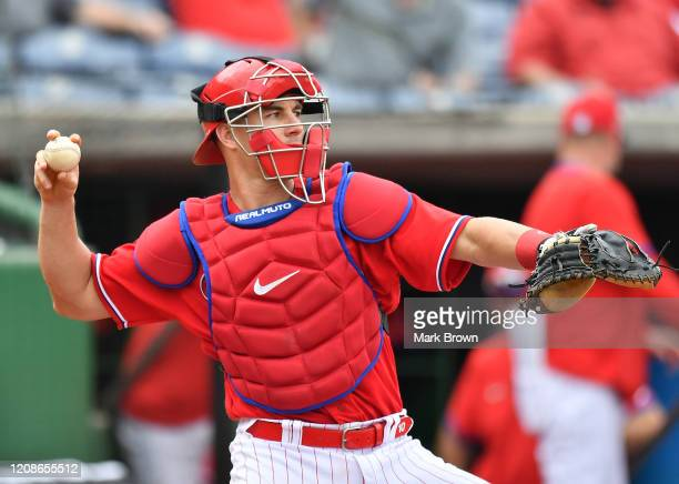 Realmuto of the Philadelphia Phillies throws the ball back to the pitcher in the third inning during the spring training game against the Toronto...