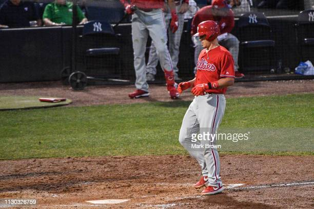 T Realmuto of the Philadelphia Phillies touches home plate after hitting a homerun in the fourth inning during the spring training game against the...