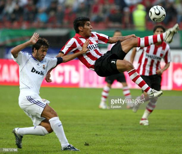 Real's captain Raul Gonzalez competes for the ball with Carlos Salcido of FC PSV Eindhoven during the Railways Cup final match between Real Madrid...