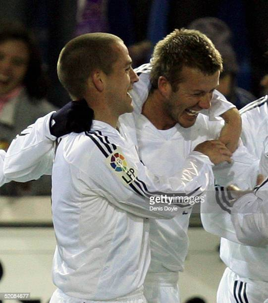 Real?s David Beckham is congratulated by Michael Owen after scoring a goal during a Numancia v Real Madrid Primera Liga soccer match at Los Pajaritos...