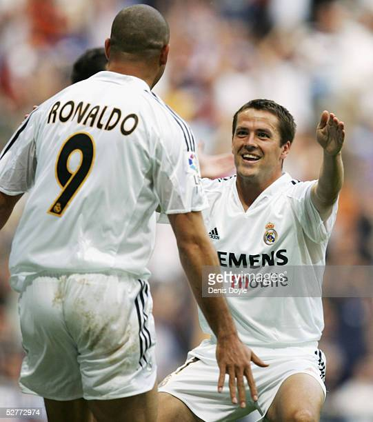 Real's Michael Owen celebrates his goal with Ronaldo during the La Liga match between Real Madrid and Racing de Santander at the Bernabeu on May 7...