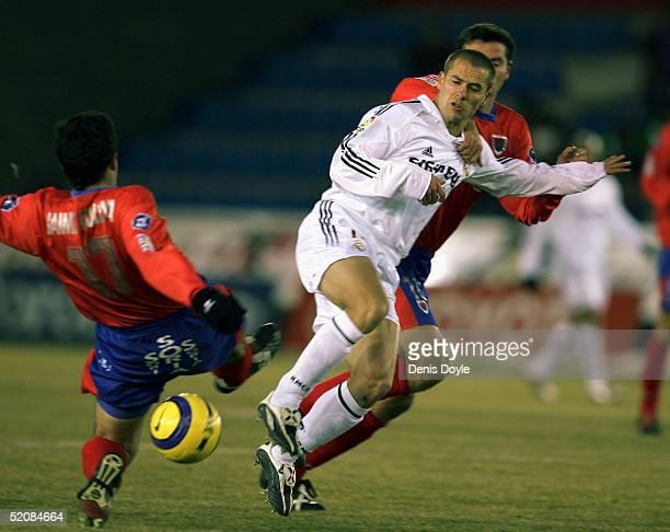 Real?s Michael Owen is tackled by Numancia?s Juanlu during a Numancia v Real Madrid Primera Liga soccer match at Los Pajaritos stadium on January 30,...