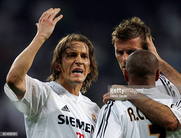 Real's Michel Salgado congratulates Roberto Carlos after he scored a goal in a Primera Liga soccer match on March 20, 2005 between Real Madrid and...
