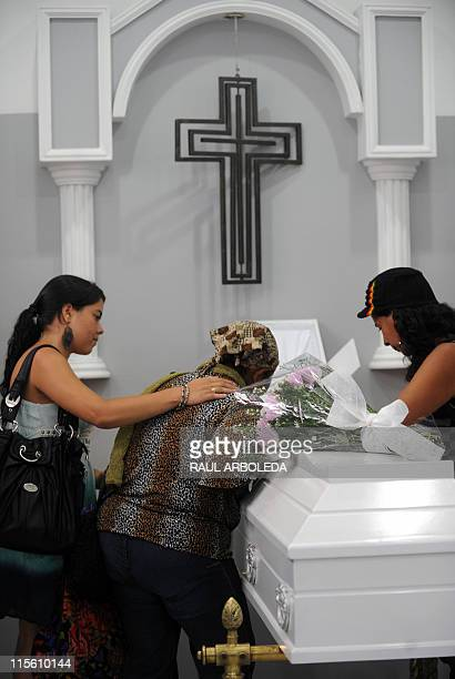 Realtives mourn next to the coffin with the remains of Ana Fabricia Cordoba Cabrera during her wake on June 8 in Medellin Antioquia department...