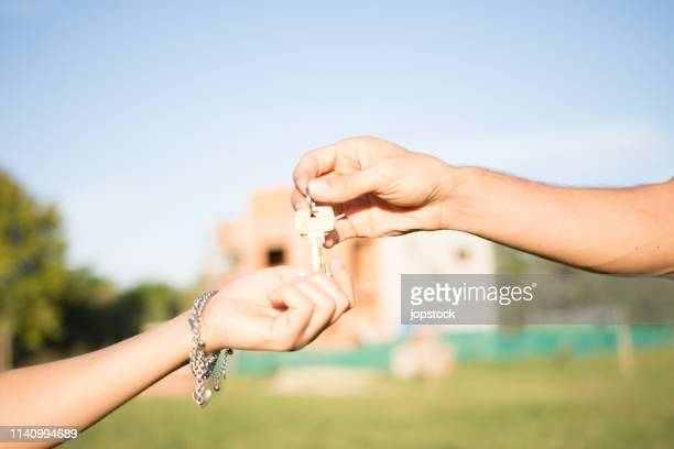 Realtor giving house key the the new owner