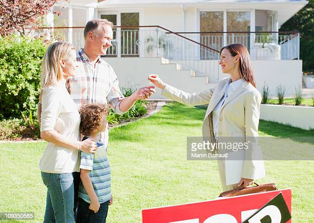 Realtor handing family the keys to their new house