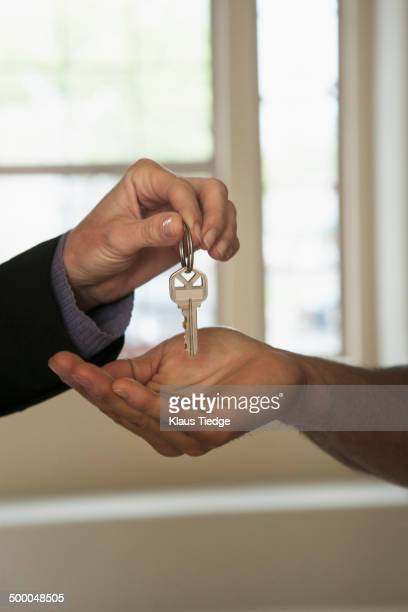 Realtor handing house keys to new owner