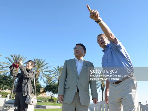 Realtor Ken Davis, right, points out the Hollywood sign to Toshiyuki Tanaka, mayor of Yokkaichi, Japan, during a visit to Hilltop Park in Signal Hill...