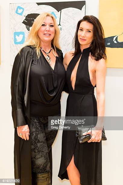 Realtors Missy Echeverria and Sonni Pacheco attend the Gallery Opening Of 'Social Distortion A Capsule Collection Of Fine Art By Billy Morrison' at...