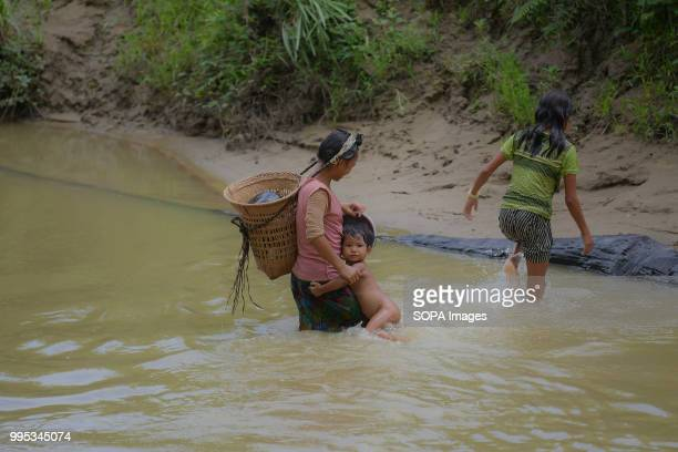 Reang women with a kid is seen in a stream with dirty water 35000 people of Reang also called Bru in Kanchanpur refugee camp fled here due to severe...