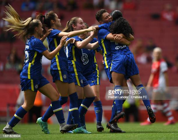Reanna Blades of Chelsea celebrates with teammate Letitia Nicholls after scoring her team's first goal during a Pre-Season Friendly match between...