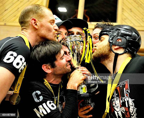 Reaper Ballistic Shrooms and Blitzkrieg of Southern Discomfort celebrate winning the Men's European Cup roller derby tournament at Walker Activity...
