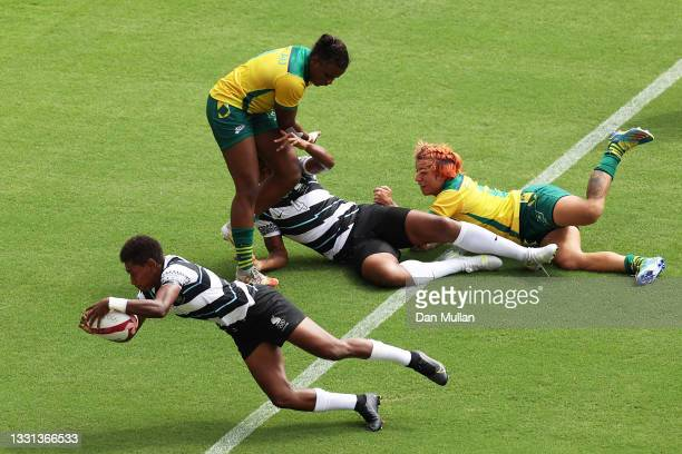 Reapi Ulunisau of Team Fiji scores a try in the Women's pool B match between Team Fiji and Team Brazil during the Rugby Sevens on day seven of the...