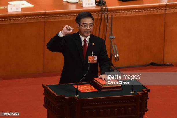 Re-appointed President of ChinaÕs Supreme People's Court Zhou Qiang swears an oath during the sixth plenary session of the National People's Congress...