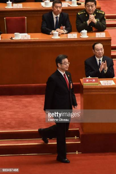 Re-appointed President of ChinaÕs Supreme People's Court Zhou Qiang walks to a podium to swear an oath during the sixth plenary session of the...