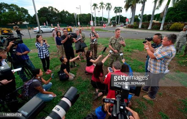 Rear Adm Robb Chadwick Commander Navy Region Hawaii speaks with the press after a sailor fatally shot two people and himself at the Pearl Harbor...