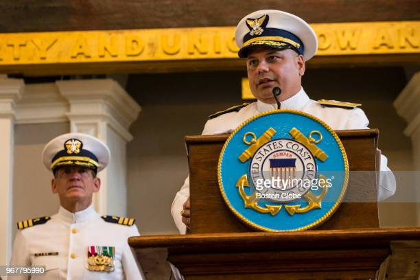 Rear Admiral Andrew Tiongson speaks during a change of command ceremony in which he relieved Rear Admiral Steven Poulin as commander of the First...
