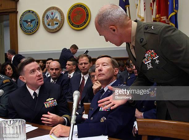Rear Admiral Bruce E MacDonald judge advocate general of the Navy left Major General Charles J Dunlap Jr deputy judge advocate general of the Air...