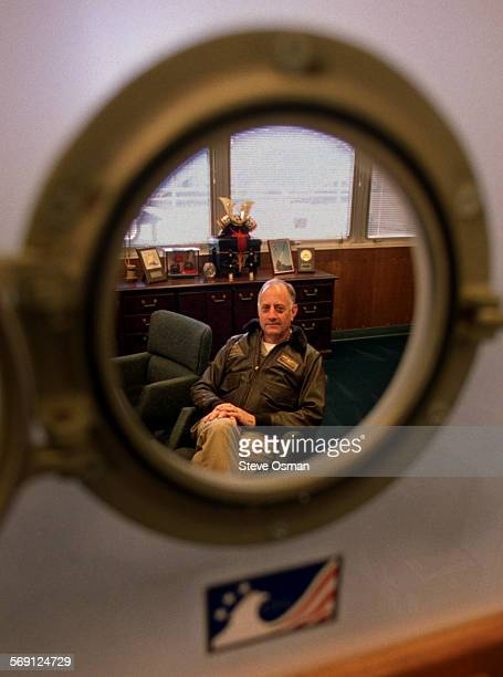 Rear Admiral Charles H Bert Johnston Jr was recently promoted to Admiral Johnston is stationed at Point Mugu He was photographed through a port hole...