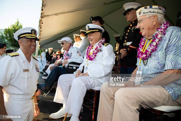 Rear Admiral Darius Banaji, U.S. Navy, left, greets Pearl Harbor survivors Lieutenant Commander Louis Conter, United States Navy, , the only USS...