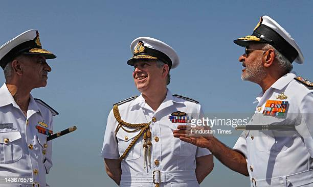 Rear Admiral Girish Luthra and Prince Andrew the Duke of York with Vice Admiral and Flag Officer DK Joshi on the flight deck of Indian aircraft...
